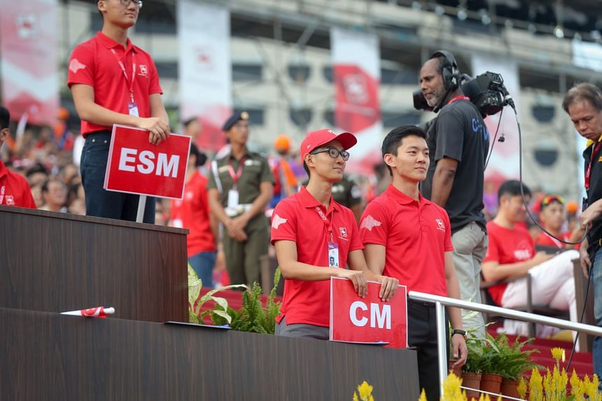 Captain (NS) Calvin Kuah (at right) plays the role of Deputy Prime Minister Teo Chee Hean during the National Day Parade rehearsals. He played the role of PM Lee in 2011.