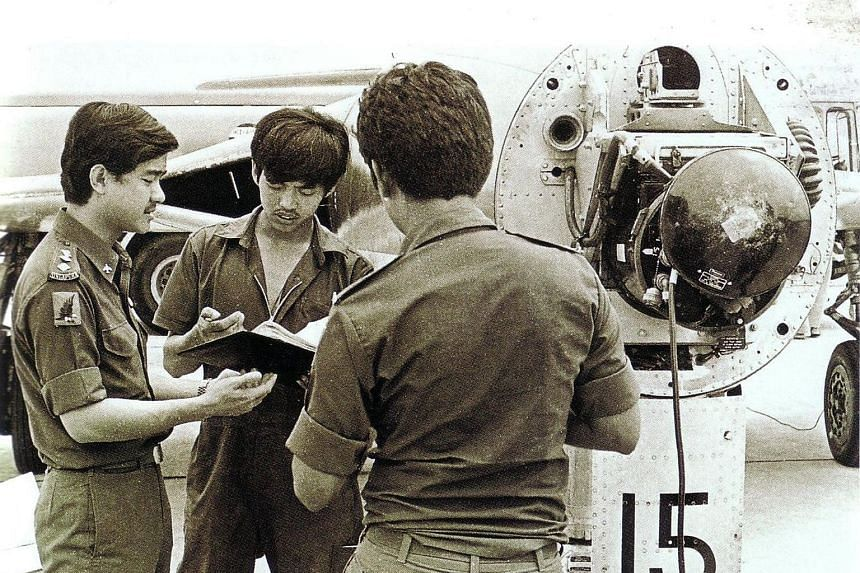 Former Air Force technician Tony Hui is flanked by Squadron Commander Michael Teo (left) and another crew member.