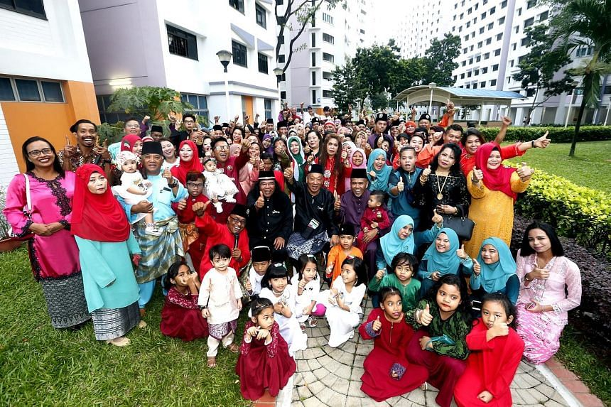 The guests at the reunion dinner yesterday which saw many of the former neighbours from Kampung Jalan Ara meeting for the first time after they moved out of their old homes in 1987. Three members of the committee that organised the event are seated i