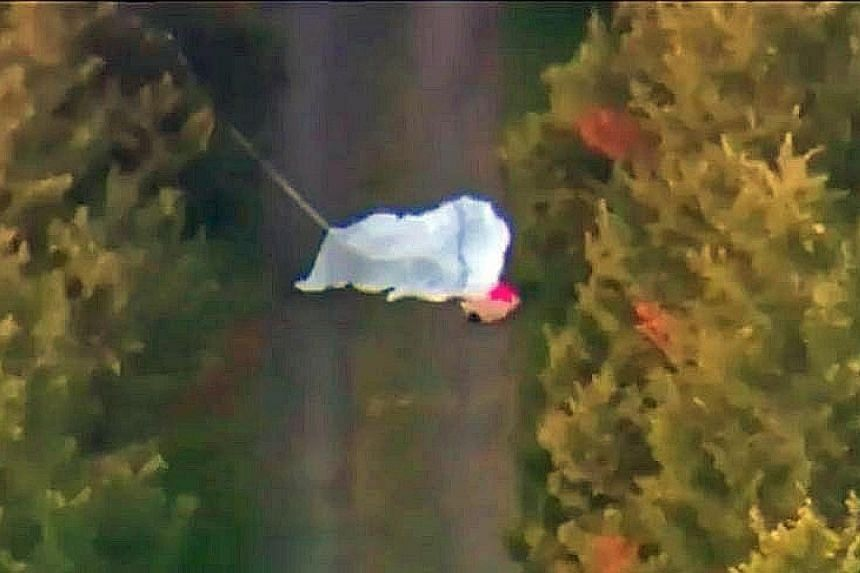 A screenshot from a video of one of the victims on the ground. Footage taken above the driveway showed the parachutes, and indicated that they opened either partially or in full. A Sydney Skydivers plane typically used to fly skydivers. A skydiver wh