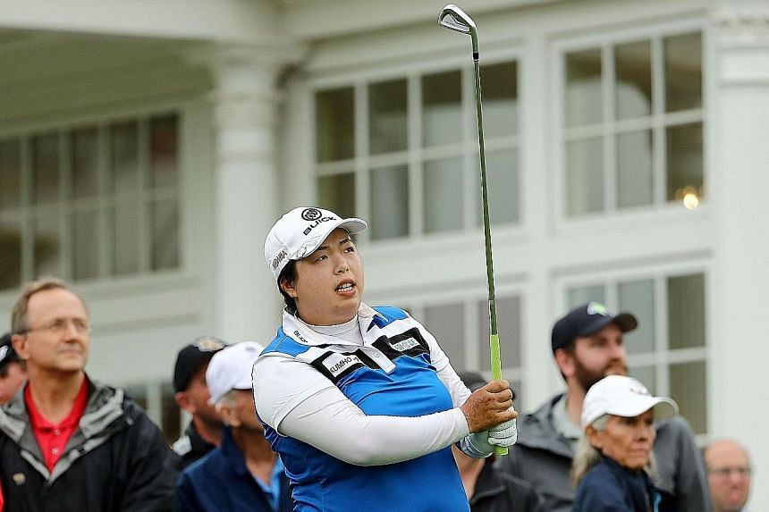 Feng Shanshan watching her shot from the 16th tee during the US Women's Open. She held a two-shot lead at the halfway mark.