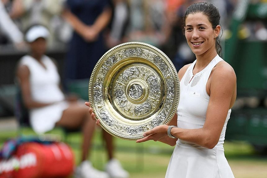 Left: Spain's Garbine Muguruza showing off the Venus Rosewater Dish after beating five-time Wimbledon champion Venus Williams. Below: A nervous Venus Williams endured the disappointment of losing a second Grand Slam final this season.