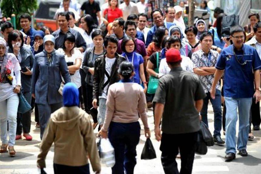 People walking on a street in Jakarta.