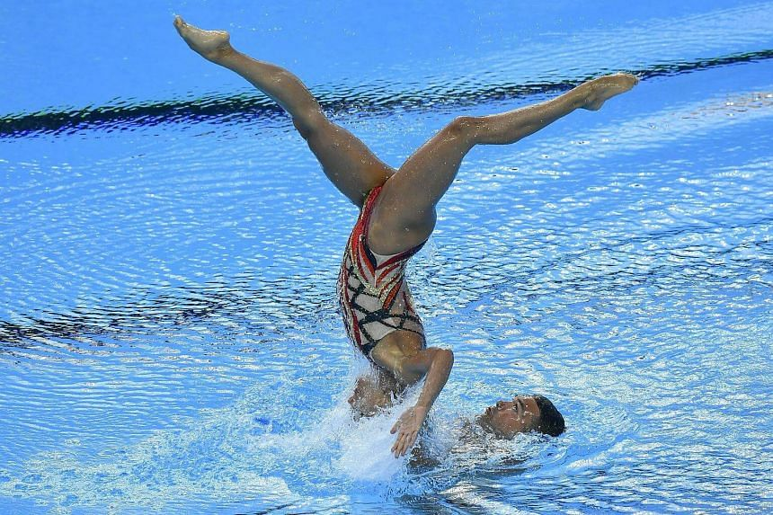 Rene Robert Prevost and Isabelle Rampling of Canada in the synchronized swimming mixed duet technical preliminary technical routine competition of FINA Swimming World Championships 2017 on July 15, 2017.