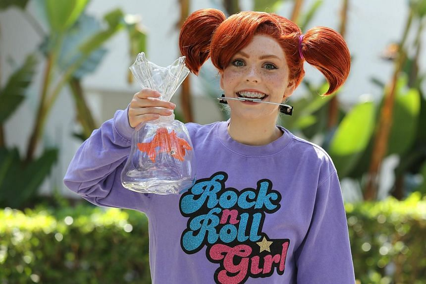 A Disney fan poses in her Darla cosplay outfit from the movie Finding Nemo during the D23 Expo in Anaheim, California, US on July 15, 2017.