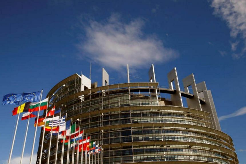 Flags of the European Union and its member states fly in front of the building of the European Parliament in Strasbourg, France on June 30, 2017.