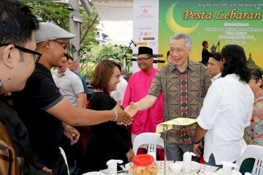 Prime Minister Lee Hsien Loong joined 700 residents of Ang Mo Kio and Sengkang West at a Hari Raya celebration on Sunday (July 14).