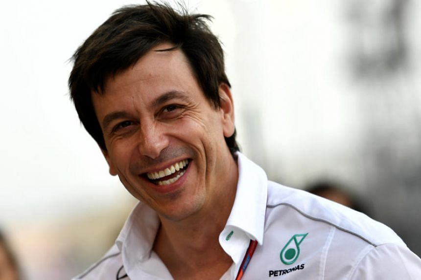 Mercedes AMG Petronas Formula One team executive director Toto Wolff smiles ahead of the Bahrain Formula One Grand Prix at the Sakhir circuit in Manama on April 16, 2017.