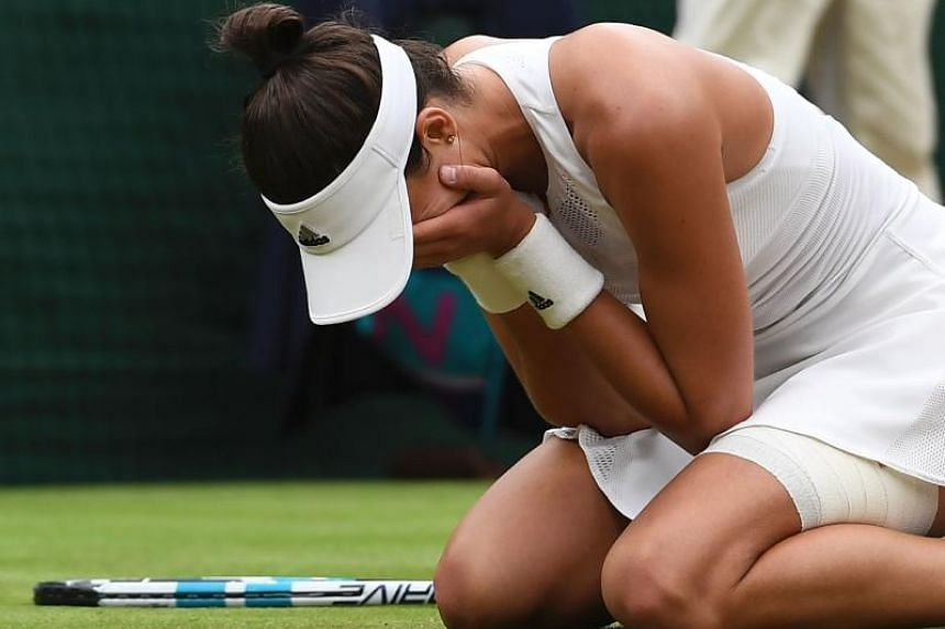Spain's Garbine Muguruza reacts after winning against US player Venus Williams during their women's singles final match in Wimbledon, southwest London, on July 15, 2017.