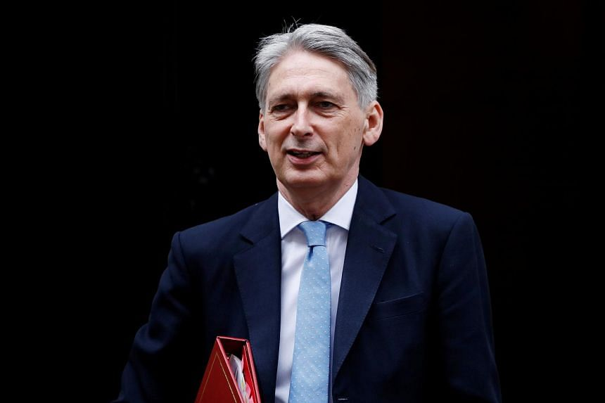 Britain's Chancellor of the Exchequer Philip Hammond leaves Downing Street in London on June 28, 2017.