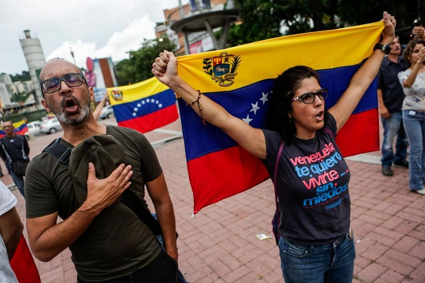 People chant during an opposition gathering held in favor of the popular consultation to be held 16 July, in Caracas, Venezuela on July 15, 2017.