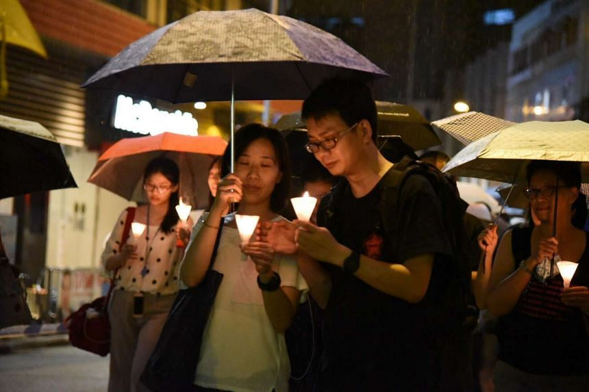 Thousands of people joined a silent protest march in Hong Kong on Saturday night in memory of late Nobel Peace laureate Liu Xiaobo.
