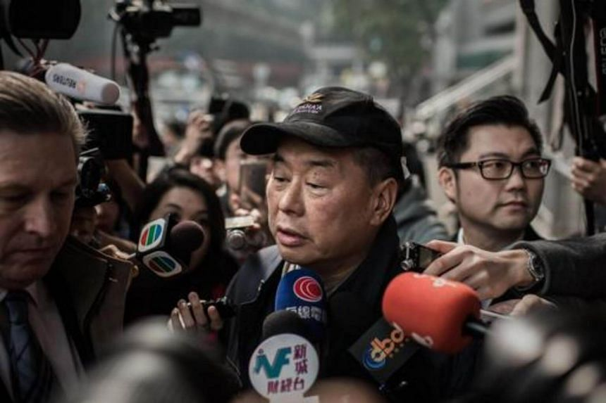 Outspoken media tycoon Jimmy Lai talks to the media after walking out of the Wanchai police station in Hong Kong on Jan 21, 2015.