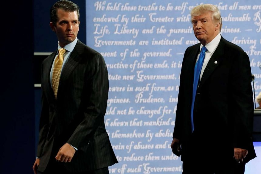 Donald Trump Jr. walks off stage with his father, Republican US presidential nominee Donald Trump, after Trump's debate against Democratic nominee Hillary Clinton at Hofstra University in Hempstead, New York, US on Sept 26, 2016.