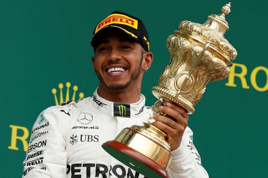 Mercedes' Lewis Hamilton celebrates his win on the podium for the British Grand Prix 2017 in Silverstone, Britain on July 16, 2017.