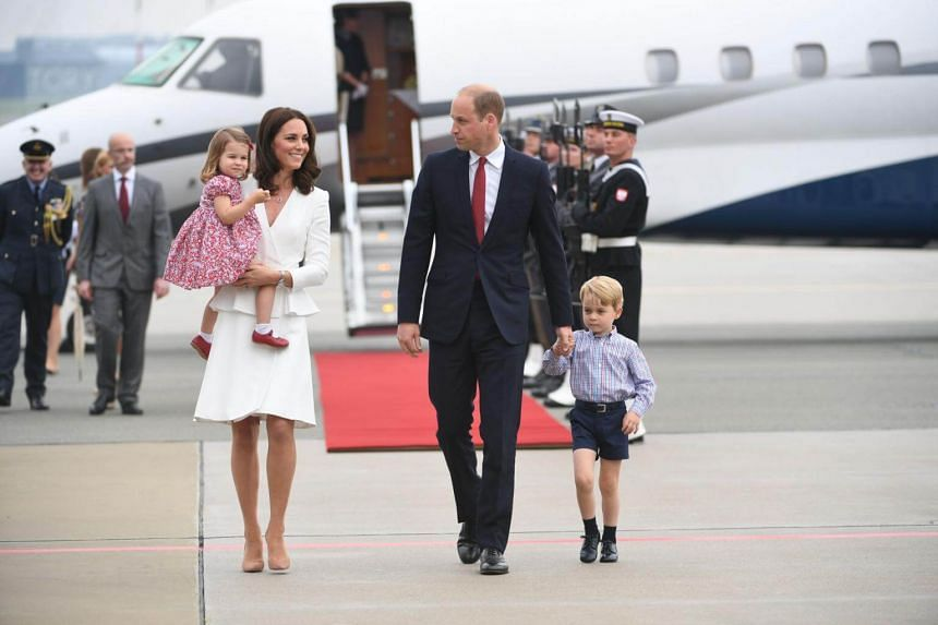 Britain's Prince William, Duke of Cambridge (right) and his wife Kate, Duchess of Cambridge (left) with their children Prince George and Princess Charlotte arrive at the airport in Warsaw, Poland, on July 17, 2017.