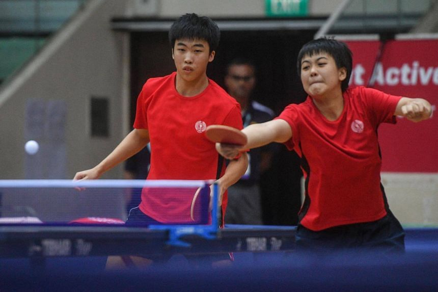 Gerald Yu (left), 16, and Goi Rui Xian, 16, in action against Dominic Koh, 15 and Liu Sijia, 13, during the Asean School Games Table Tennis Mixed Doubles Finals at Toa Payoh Sports Hall on 17 July, 2017.