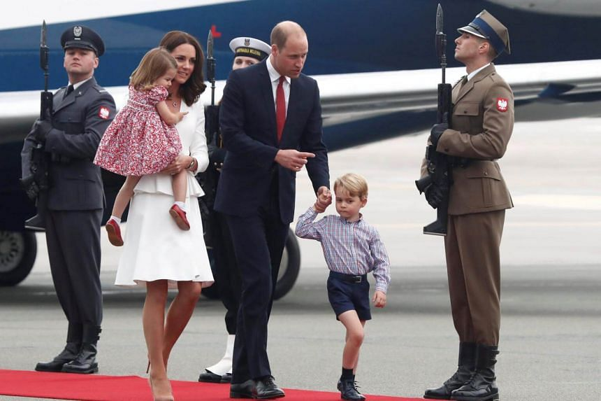 Prince William, the Duke of Cambridge, his wife Catherine, The Duchess of Cambridge, Prince George and Princess Charlotte arrive at a military airport in Warsaw, Poland, on July 17, 2017.