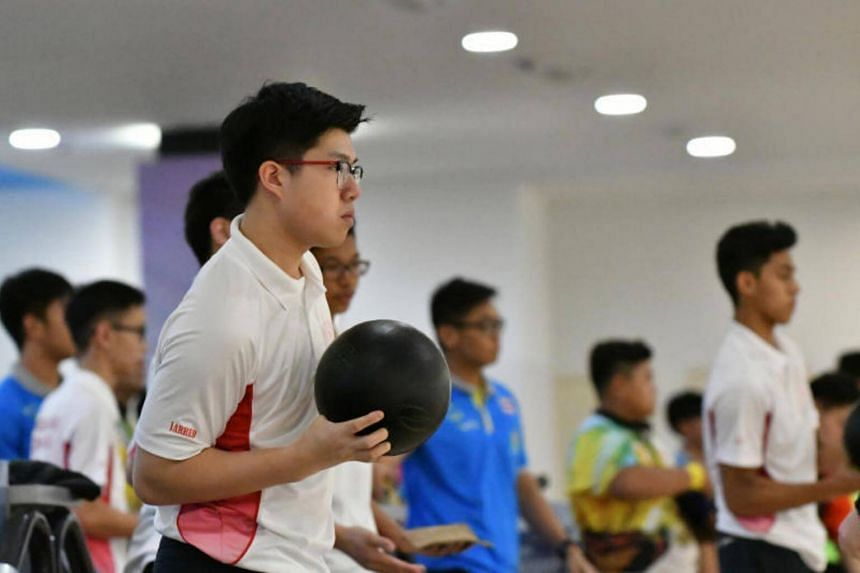Singapore youth bowler Jarred Lim prepares to bowl in the boys' doubles event at the 9th Asean Schools Games.