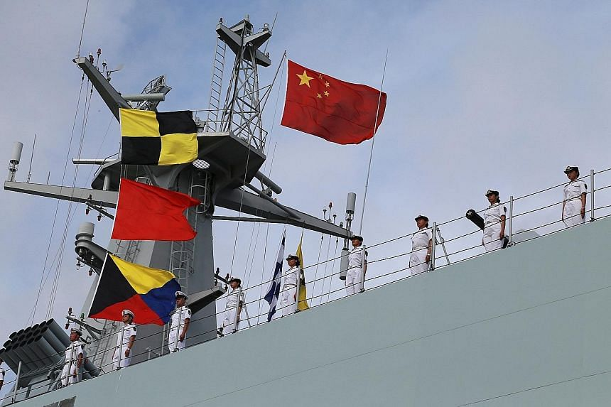 Chinese troops aboard a navy ship sailing off from the port of Zhanjiang last Tuesday.