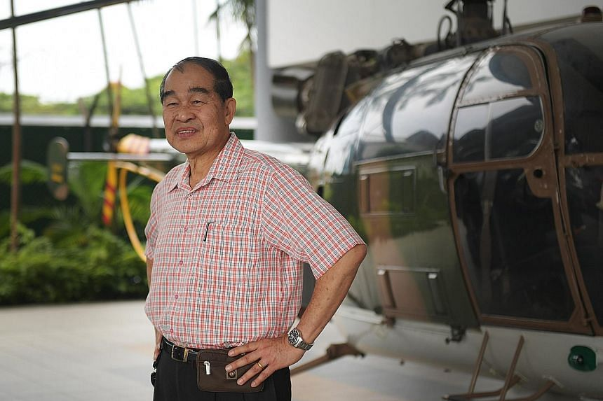 Above: The state flag is flown by a Chinook helicopter and its Apache escorts over the anchorage to the south of the Singapore mainland. Left: Lieutenant- Colonel (Ret) Leo Tin Boon, a former pilot, beside an Alouette III helicopter at the Air Force