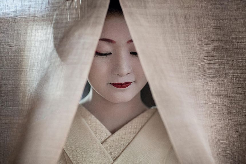 In more than 80 photos, photographer Philippe Marinig captures how maiko in Kyoto live and work.