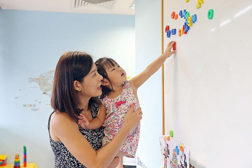 Madam Audrey Wu, 38, and her daughter Summer Tan, two. The study's finding puts Madam Wu at ease; the housewife had initially limited Summer's language exposure to English as she had read that teaching babies two languages concurrently would confuse