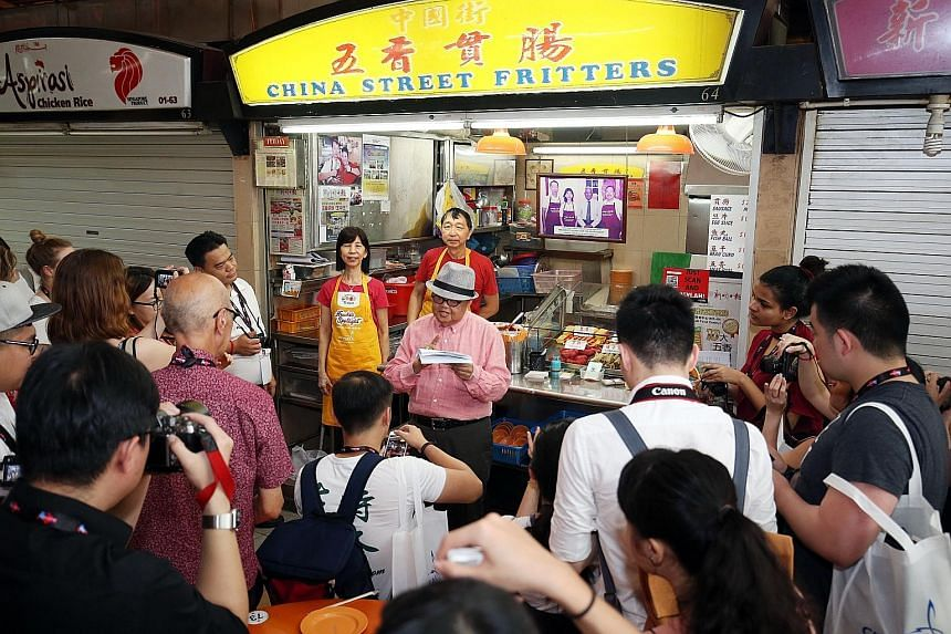 Celebrity Moses Lim telling the media about the signature dishes that China Street Fritters offers, with stall co-owners Ng Kok Hua - who is Mr Richard Ng's brother - and his wife Ong Siew Eng in the background. Left: Roasted pork, char siew and roas