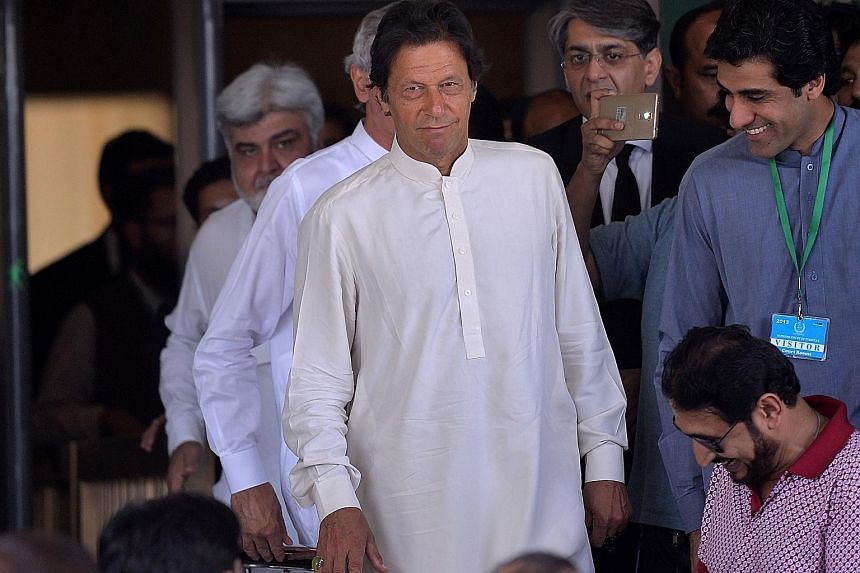Opposition leader Imran Khan (above) leaving the Supreme Court in Islamabad in May after attending a hearing on the so-called Panama Papers case involving allegations of corruption against Prime Minister Nawaz Sharif (left).