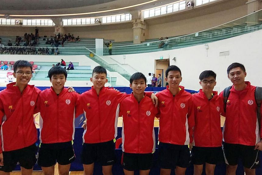 From left: Singapore's victorious paddlers Josh Chua, Gerald Yu, Dominic Koh, Beh Kun Ting, Shawn Chua, Bevan Tan, and coach Tan Chiew Sern.