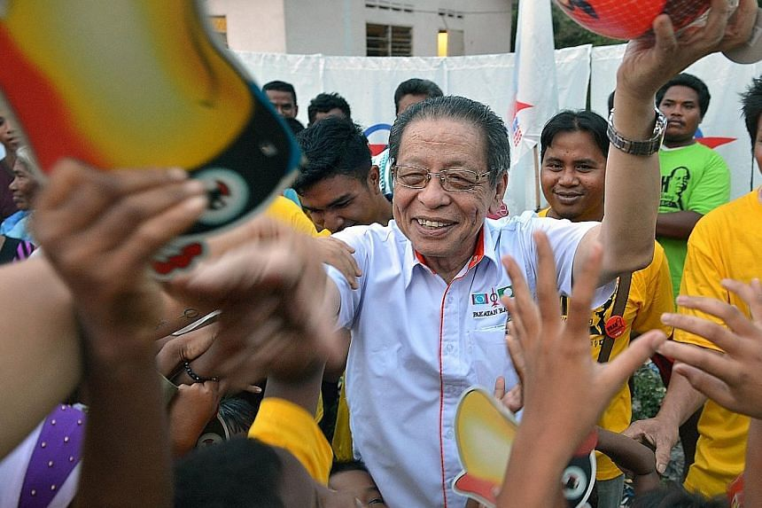 DAP stalwart Lim Kit Siang giving out party souvenirs in Gelang Patah, Johor in 2013. That year, the opposition party stormed to a record 38 parliamentary seats and was unbeaten in its Penang stronghold. It is now the second largest party in Parliame