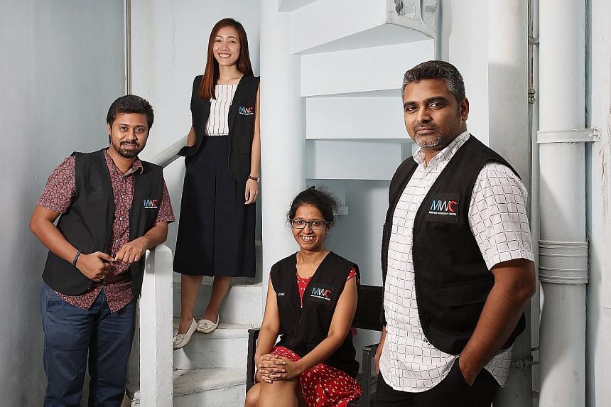 From left: Migrant Workers' Centre staff T. Nakulan, Jeane Liu, Ishrat Khan and Joshua Sham form part of the non-governmental organisation's emergency response team.