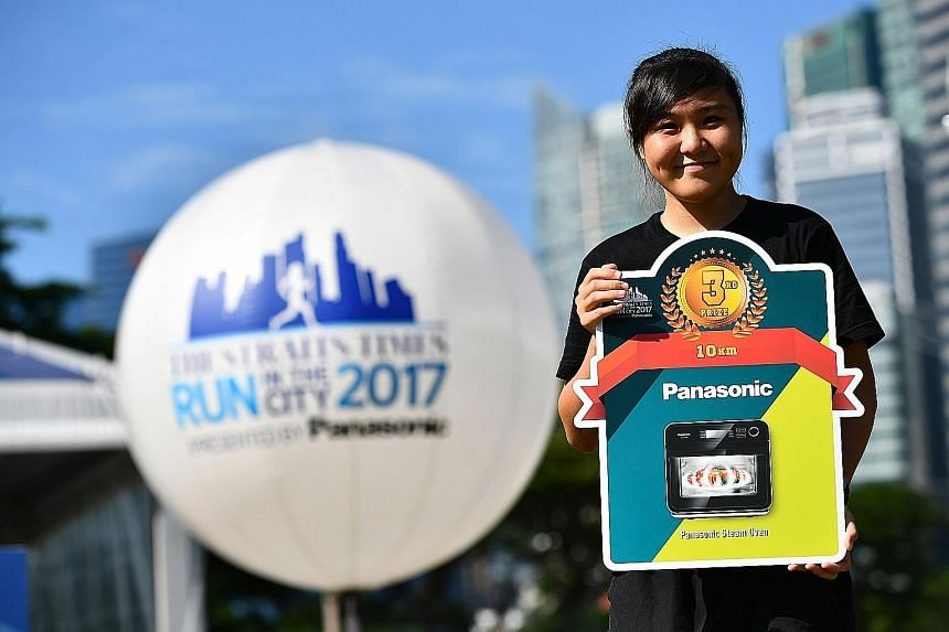 """Ms Abigail Sim, who came third in the ST Run's 10km women's race yesterday, said she was """"very grateful"""" for the help she received as a student from The Straits Times School Pocket Money Fund. The 20-year-old is now a medical undergraduate."""