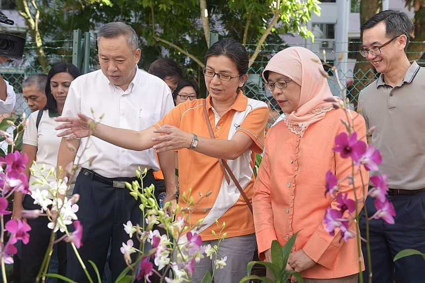 Speaker of Parliament Halimah Yacob touring an orchid garden in her Marsiling constituency yesterday. She is widely seen as a likely establishment candidate for September's election.