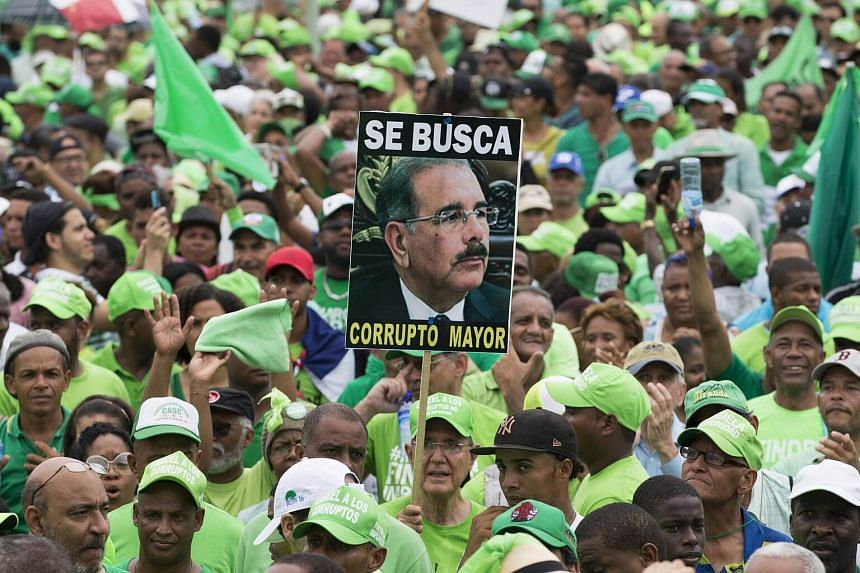 Thousands of people take part in a march against corruption and impunity in Santo Domingo, on July 16, 2017.