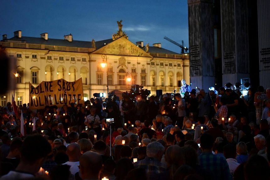 Protesters gather during a candlelight rally to protest against judicial reforms in front of the Supreme Court in Warsaw, Poland on July 16, 2017.