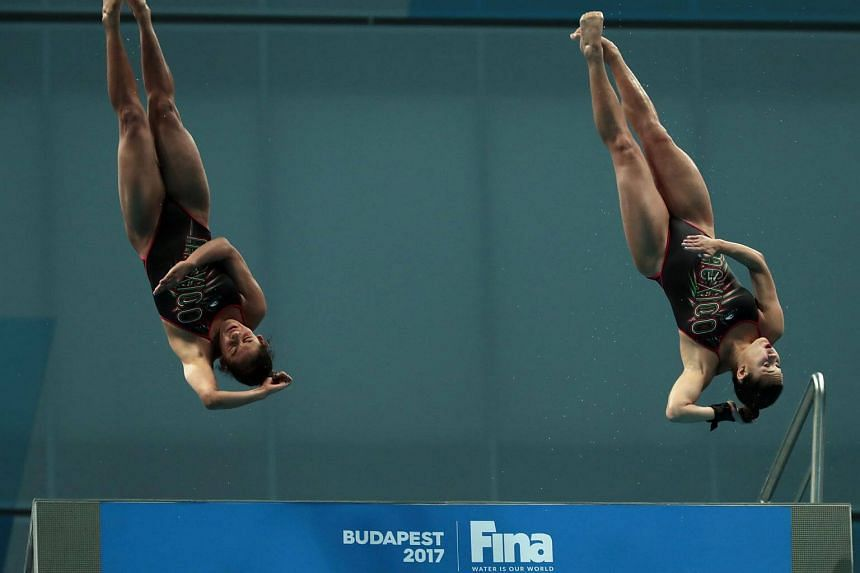 Mexico's Gabriela Agundez Garcia and Samantha Jimenez Santos compete in the women's 10m platform synchro final during the diving competition at the 2017 Fina World Championships on July 16.