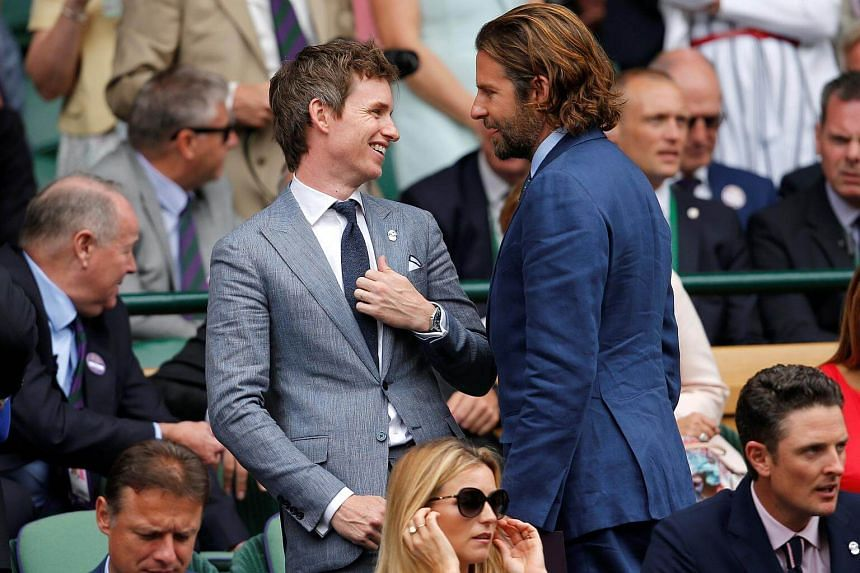 Actors Eddie Redmayne and Bradley Cooper in the Royal box on Centre Court in Wimbledon on July 16, 2017.
