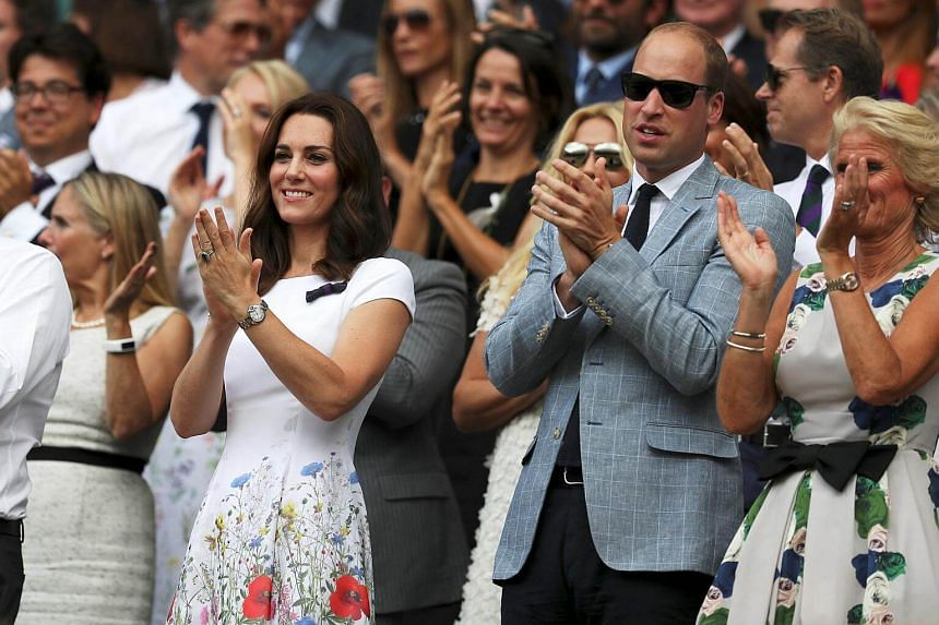 Prince William and Catherine, the Duchess of Cambridge applaud as  Roger Federer celebrates winning the final.