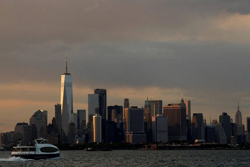The Manhattan skyline is seen during sunset from the Brooklyn, New York.
