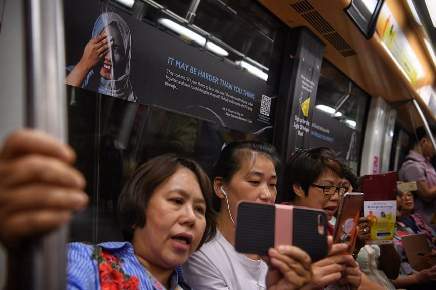 A display as part of a mental health awareness campaign by Touch Community Services and Nanyang Polytechnic is seen on a train along the North East Line.