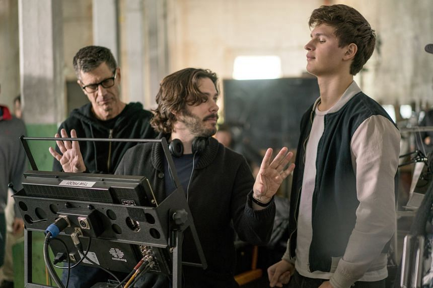 Director Edgar Wright (centre) and actor Ansel Elgort (right) on the set of the heist thriller Baby Driver. PHOTO: TRISTAR PICTURES