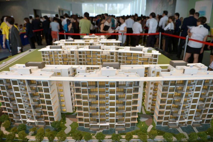 Potential buyers at the aunch of a private condominium.