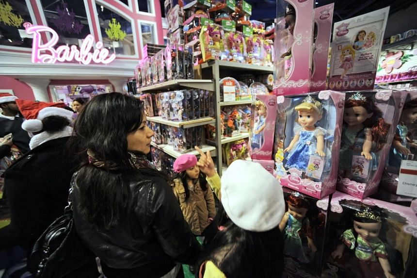"""Shoppers at a Black Friday sale at a Toy """"R"""" Us store in New York, US, on Nov 24, 2011."""