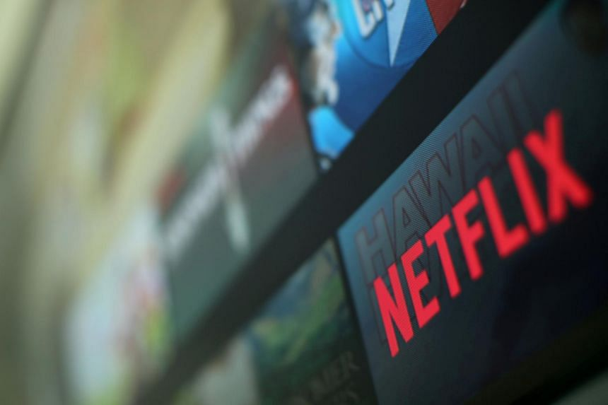 The Netflix logo is pictured on a television in this illustration photograph.