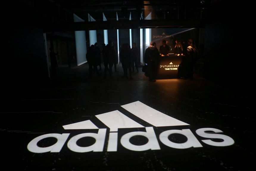 An Adidas logo is seen at the new Futurecraft shoe unveiling event in New York, on April 6, 2017.