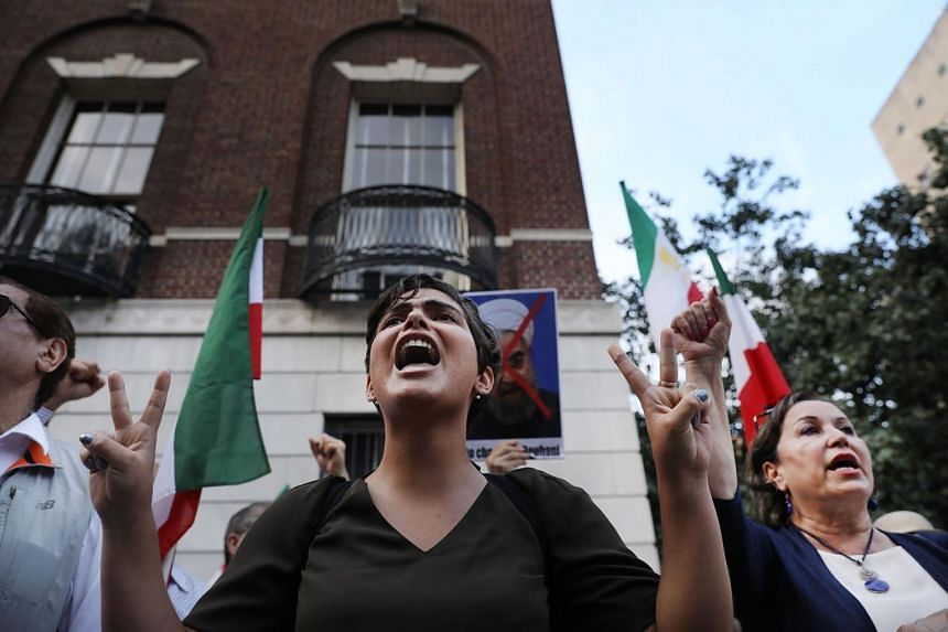 Protesters critical of the Iranian government demonstrate outside of the Council on Foreign Relations.