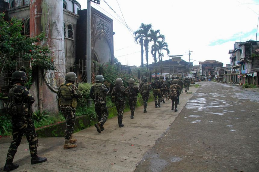 Philippine troops marching towards the frontline where they are battling militants in Marawi on the southern island of Mindanao, on July 12, 2017.