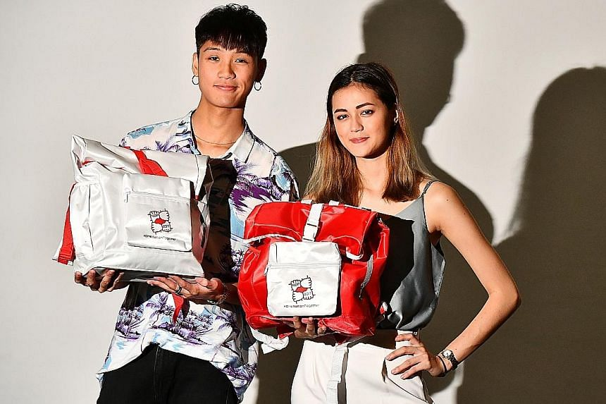 Left: Lasalle College of the Arts graduate Riche Tay and coursemate Denise Richter spent about a month designing the funpacks. Above: Some of the items inside include a mini Singapore flag, which doubles as a flashing LED light, and a handy paper ban