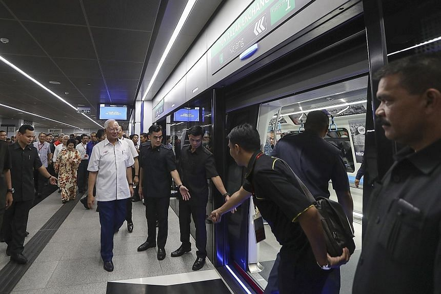 Malaysian Prime Minister Najib Razak arriving for a ride after the opening of the second phase of the Greater Kuala Lumpur MRT line yesterday.